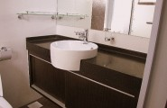 Charming Decoration Ideas Into A Girly Look Bathroom : Clean Bathroom Furnitures And Decoration Ideas Into A Girly Look Circle Sink Black Marble Counters Toilet Modern Cabinet Design Mounted Soap Storage