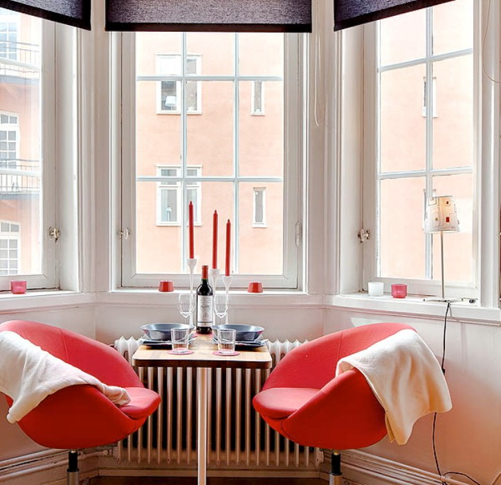 Interior Design Ideas For Small Apartments: Colorful Bright Glamour Room Apartment In Red With Simple Black Curtain And Small Table Alongside Chair Sofa Beautifull View And Bay Window