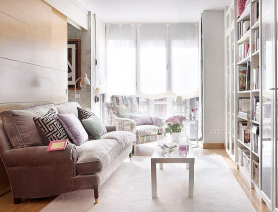 How To Design 40 Square Meter Apartment Comfy: Comfy Simple Living Room With White Theme And Wrapped In Brown Fabric Sofas Lining The Walls With Wood Wool Carpet With A Beautiful Bookcase Beside The White Color Window Curtain1