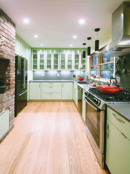 Apply Wok Le Creuset For Your Wonderful Kitchen : Contemporary Kitchen With Le Creuset Classic Braiser Rustic Brick Wall Modern Stove Stainless Steel Exhaust Hood