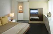 Various Cool Dvd Storage Ideas : Contemporary Master Bedroom With Custom Bed And Mesia Center And Space And Storage And Very Little Connection To The Rest Of The Apartment