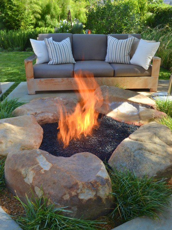 Terrific Propane Fire Pits Table For Decks And Patio : Contemporary Patio With Propane Fire Pits For Decks And Kind Of Pebbles Used In Pit And Gas Fire Ring With The Natural Stones Around Are Simply Retaining The Glass