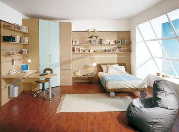 Cool Bedrooms For Teens: Cool Bedroom For Teens 22 Bed On Wheel Desk Computer Chair Bookshelves Wall Shelf Lamp Closet Window Rug Wooden Flooring Ideas