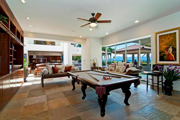 Tropical Gardens And Ultimate Villa Design In Maui, Hawaii: Thousand Waves Holiday Villa: Cool Brown Scheme Slate Tile Play Room Interior Decor With Billiard Table And Indonesian Style Lounge With Cushions In Front Large Glass Window And Modern Ceiling Fan Ideas