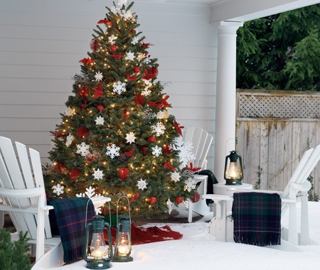 Front Porch Christmas Decorating Ideas: Cool Christmas Tree Design With Outdoor Lights And Ornaments And Wrapped Faux Presents Under The Tree With White Wooden Armchair And Skandinavian Style Blankets Ideas