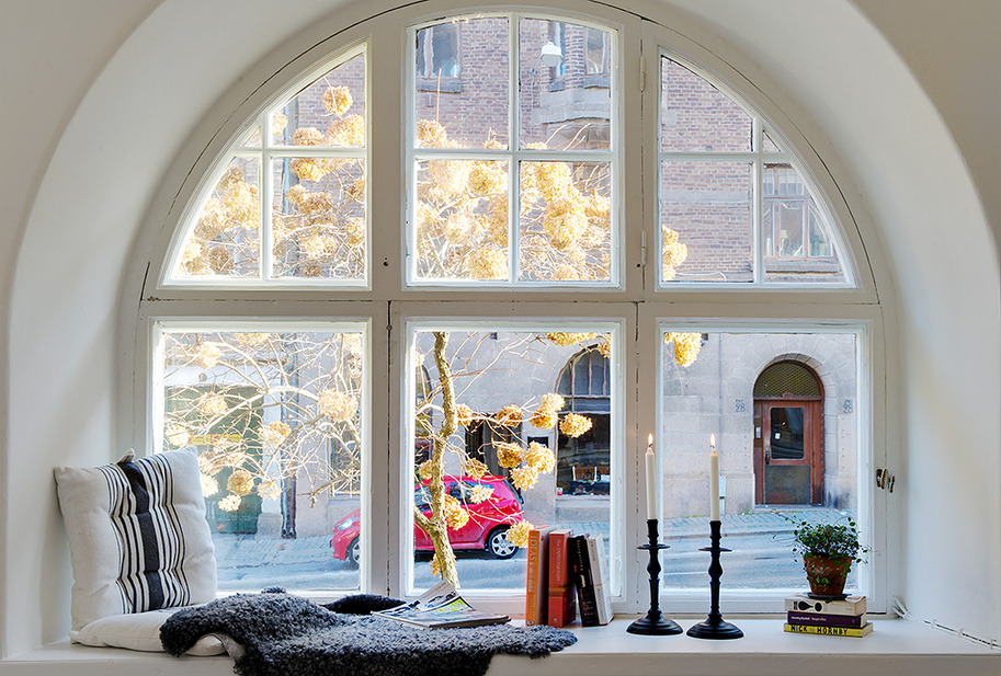 Decorating Tricks to Make A New House Cozy and Welcoming: Cool Curve Window Design With Book Candle And Cushion Ideas