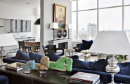 Inspiring Cozy Apartment Design Ideas In Bright Colors : Cool Deep Blue Sofa With Deep Blue Cushions And Tablelamp Indoor Fireplace Dining Table Bay Window With Great View