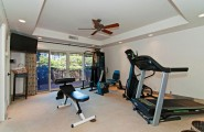 Tropical Gardens And Ultimate Villa Design In Maui, Hawaii: Thousand Waves Holiday Villa : Cool Drop Ceiling Gym Room Interior Decoration With Large Glass Door Curtain And Ceiling Fan