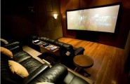 Home Theater Room Planning Ideas : Cool Home Theater Design With Black Leather Sofas Cushion Coffee Table Wooden Flooring Ideas