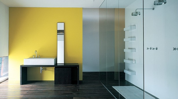 Modern and Unique Bathrooms Design from Flaminia: Cool Modern Dark Brown Wooden Floor Bathrooms Interior Design With Bathroom Vanities In Front Of Yellow Wall With Concealed Open Shower Separated By Glass Wall ~ stevenwardhair.com Bathroom Design Inspiration