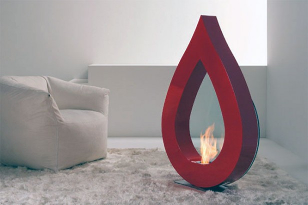 Awesome Stylish Small Modern Moveable Fireplace Design: Cool Moveable Small Modern Red Teardrop Shaped Gas Fireplace On White Area Fur Rug And White Single Sofa ~ stevenwardhair.com Fireplace Inspiration