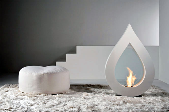 Awesome Stylish Small Modern Moveable Fireplace Design : Cool Moveable Small Modern White Teardrop Shaped Gas Fireplace On White Area Fur Rug And White Pouffe