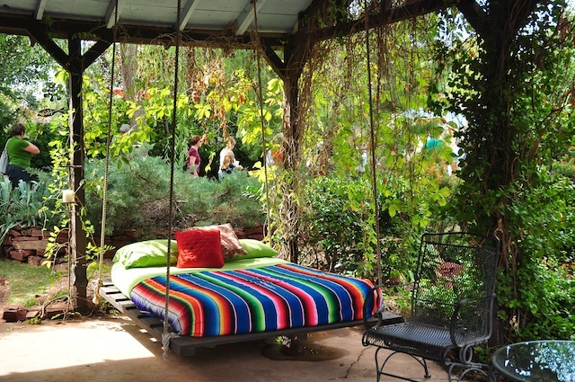Breathtaking Relaxing Outdoor Hanging Bed Design Ideas: Cool Outdoor Bed With Relaxing Cozy Outdoor Hanging Bed With Thick Soft Bedding And Fun Colorful Stripe Bed Sheet In A Rustic Country Porch
