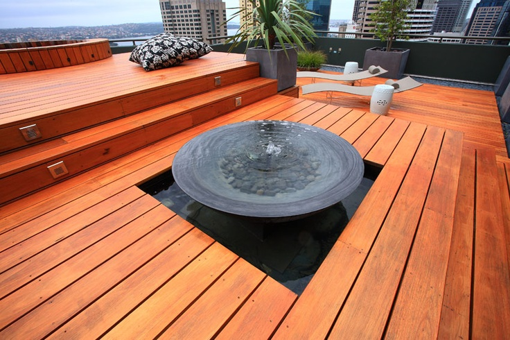Astonishing Outdoor Deck Design Ideas With Unique Style : Cool Outdoor Deck Design With Beautiful Charm Wooden Floor Deck Design With Vamouse Style Outdoor Furnitures Interior With Wound Stone Waterfall And Lazy Chairs