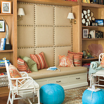 Awesome Padded Wall Panel Design As A Wall Decor Ideas : Cool Padded Wall Panel As A Backdrop Of Wooden Shelves Design With Seat Cushions And White Rattan Armchair And Pouf