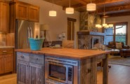 Fabulous Of Reclaimed Wood Kitchen Cabinets : Cool Reclaimed Wood Modern Kitchen Interior Design With Cabinetry And Counter Tops And Island Tops And Reclaimed Beamed Ceilings With Old Floorboards Fireplace Lamps Sofa Ideas