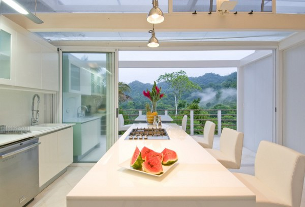 ISEAMI House: Self Sustainable White Steel Villa In Peninsula de Osa, Costa Rica: Cool White Steel Villa Kitchen Design With Cabinet Chairs Pendant Lights Glass Sliding Door Scenic Ideas