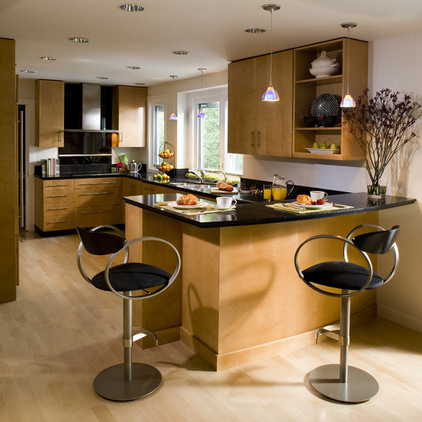 Solid and Hardest Wood Flooring for Our Home: Cozy Contemporary Kitchen Hardest Wood Flooring With Black Glossy Countertops Minimalist Pendant Lamps And Modern Barstool