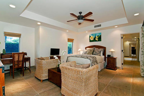 Tropical Gardens And Ultimate Villa Design In Maui, Hawaii: Thousand Waves Holiday Villa: Cozy Light Brown Scheme Slate Tile Floor Bedroom Interior Decoration With King Bed And Bedside Table Lamps And Rattan Seats And Drop Ceiling Fan