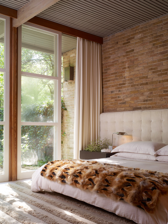 Extraordinary Fur Area Rug At Home : Cozy Midcentury Bedroom Brick Wall White Curtain And White Bed At Furry Area Rugs