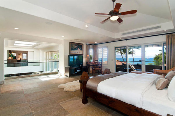 Tropical Gardens And Ultimate Villa Design In Maui, Hawaii: Thousand Waves Holiday Villa : Cozy Slate Tile Floor Bedroom Interior Decoration With Wooden Bed And Drop Ceiling Fan With Large Glass Door Ocean View