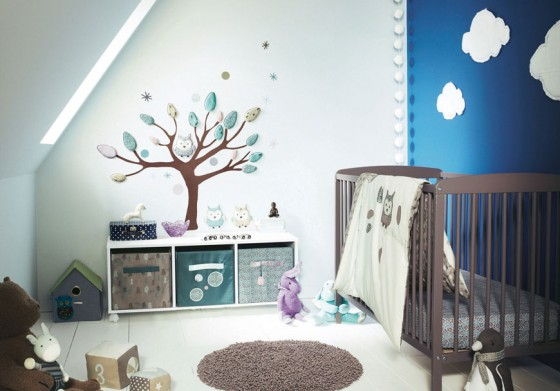 Cozy And Cheerful Modern Nursery Room Design: Cozy Sloping Wall White Blue Nursery Room Design With Cool Wooden Chocolate Cribs Design With Nursery Wall Decor And White Wooden Flooring