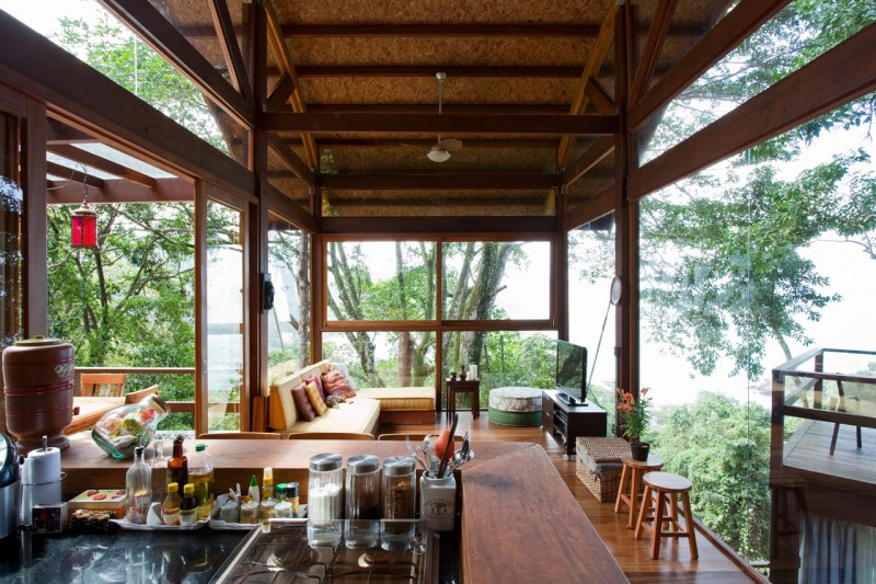 Unusual Wild Nature and Cool Modern Home Designs on Tropical Forest: Cozy Unusual Wild Nature And Cool Modern Home Designs On Tropical Forest With Ceiling Fan TV Cabinet Large Glasses Wall Wooden Floor Assorted Colors Cushions