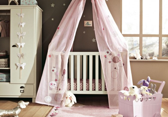 Cozy And Cheerful Modern Nursery Room Design: Cute Brown Scheme Nursery Room Design With White Wooden Crib With Pink Netting And Pink Area Rug And Cream Closet On Wooden Flooring Ideas