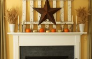 Halloween Mantel Decorating Ideas for Spooky Party : Cute Halloween Fireplace Decorating Ideas Bronze Star On A White Fence Decoration Small Orange Pumpkins Four Candle Stands On A Mantel