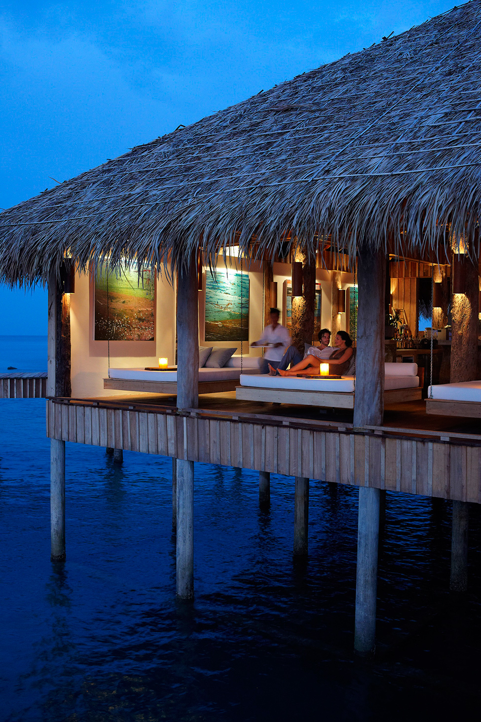 Song Saa : Private Remote Island Resorts In Cambodia: Detail Of Stunning Over Water Vista Bar Design At Night