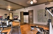 Atonishing In House Gym Space Design For Urban Living : Eciting Home Gym Designs With Elliptical Treadmill Or Multi Functional Home Gym System With Wooden Ceiling And Cabinet