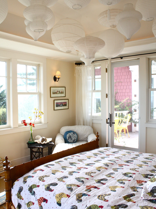 How To Make Paper Lanterns For Kids: Eclectic Bedroom With Lanterns Hanging From The Ceiling Look Like Clouds And White Chic Paper Lanterns Scoop Up A Funky Neon Sign Or A Vintage Marquee Letter At The Flea Market
