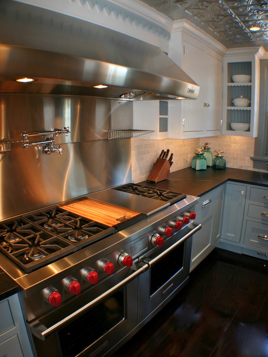 Modern Stainless Steel Backsplash In The Kitchen: Eclectic Kitchen With Stainless Cover And The Butcher Block Cover For The Grill And The Griddle And Stainless Steel Backsplash White Cabinet Plus Green Jars