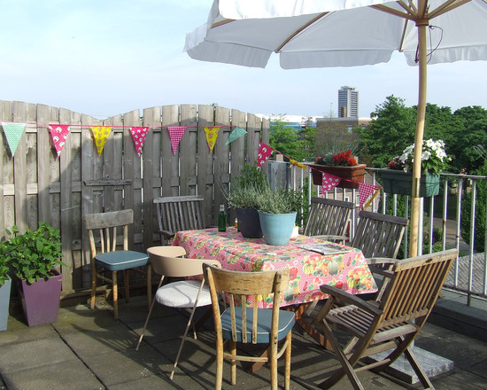 Amazing Party Decorations Pictures : Eclectic Patio Party Decorations With Festive Atmosphere Decorating Flags Along Fence Including Indoor Furniture Brightly Colored Linens