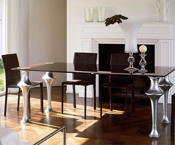 Picture Of Awesome Modern Dining Table Design: Elegant Form And Modern Finishes Imposing Glass Surface Dining Table Design Ideas With Cool Substantial Legs With Vase Fireplace Chairs And Wooden Flooring Ideas