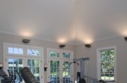 Inspiring Strategically Placed Gym In A Stylist Living Room : Elegant Minimalist Decoration For Your Home Gym Design Ideas With Fitness Equipment Treadmill High Ceiling