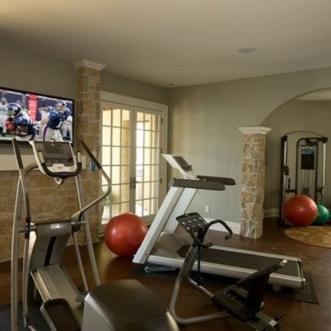 Atonishing In House Gym Space Design For Urban Living : Exciting Creative Home Gym Designs With Compact And Versatile Fitness Equipments Elliptical Treadmill And Nice Stone Wall Decor