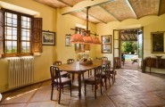 Use Terracotta Color for Astounding Ambiance : Farmhouse Dining Room Terra Cotta With Wood Dining Table And Chairs Plus Rustic Pendant Lamps