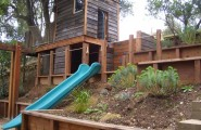 Wonderful Backyard Landscaping Ideas For Kids : Fascinating Rustic Backyard Landscaping Ideas With Kids Treehouse Playhouse With Slide Climbing Wall And Swing Set