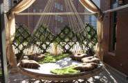 Calm Relaxing Outdoor Hanging Beds For You : Fun Outdoor Hanging Bed Grecian Feel Round Shaped Center Multiple Strings Located Sounding By Wooden Railling Put On Terrace
