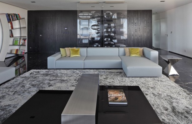 Sleek Apartment With Smart Look And Upstanding Approach: Fur Rug Long Sofa With Remarkable Black Marble Floor Design Assorted Colors Cushions Unique Book Rack Marble Floor ~ stevenwardhair.com Apartments Inspiration