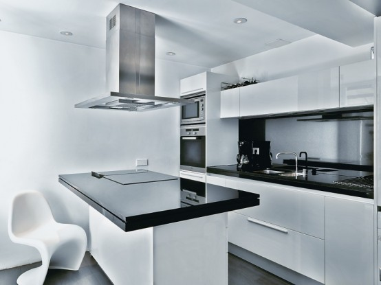 Captivating Apartment Interior That Will Satisfy Your Need: Futuristic Style Kitchen With Sleek And Lururious Appliances Glossy Finishing Modern Chair Black And White Pallette