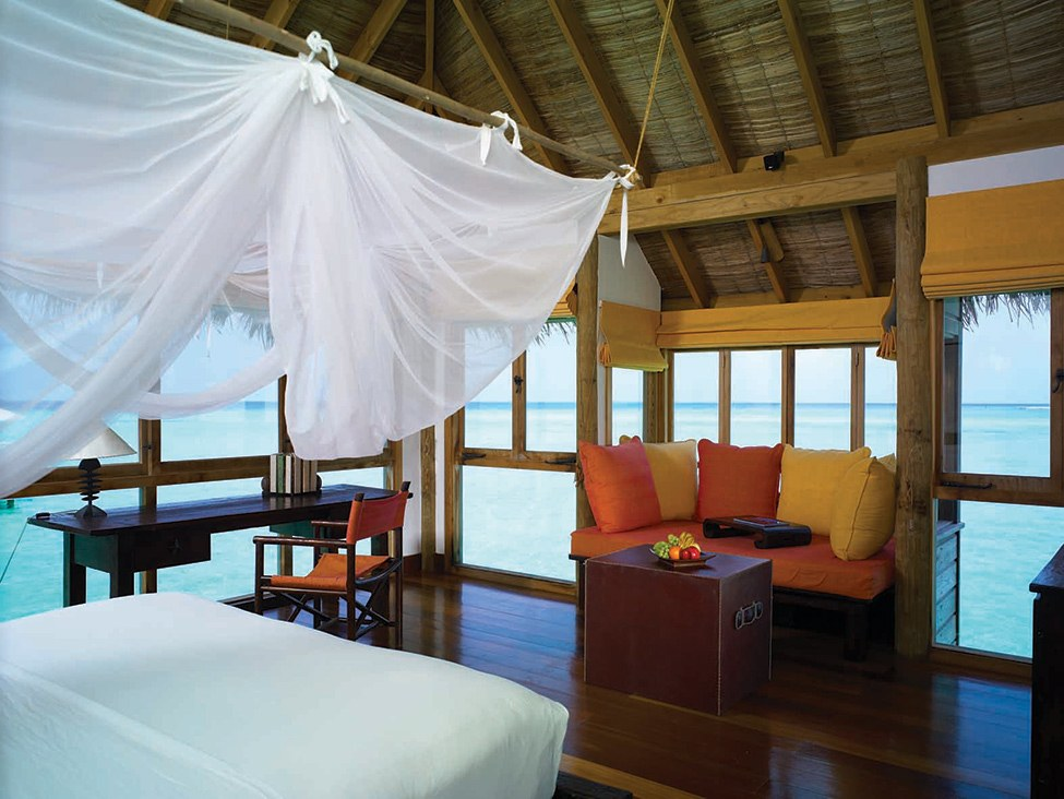 Amazing Exclusive Resort In Maldives: Gili Lankanfushi : Gili Lankanfushi Resort Villa Suite Bedroom Interior Design With Mosquito Nets Sofa Cushions Table Chair Wooden Flooring Sea View Ideas