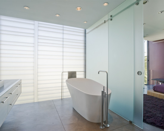 Cozy Translucent Sliding Doors: Glass Sliding Door At Contemporary Bathroom With Free Standing Tub And Frosted Glass Sliders For The Closet Door