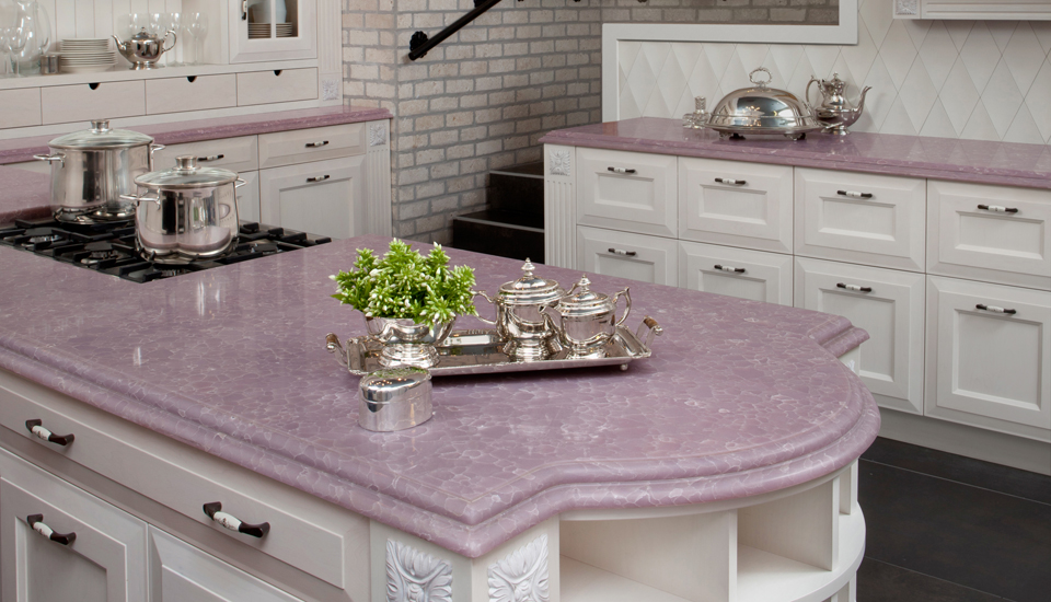 CaesarStone Best Value Countertops Design : Gorgeous Modern White Kitchen Cabinet With Lavender Color Queen Of Hearts Countertop Design With Parallelogram Tile Kitchen Backsplash With White Brick Wall And Wooden Flooring Ideas