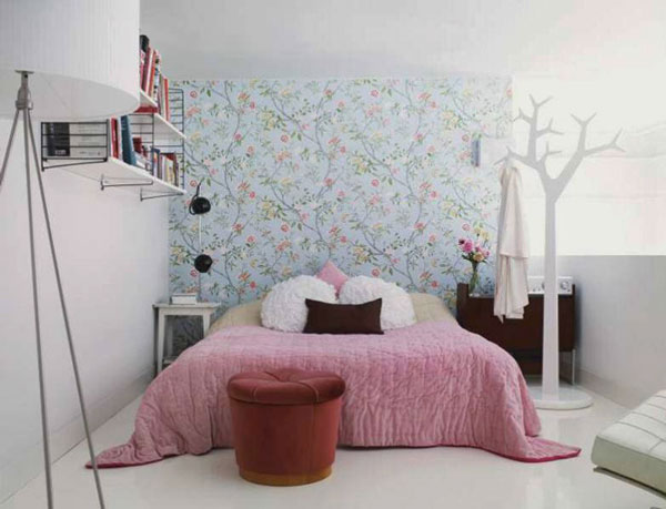 Excellent Ideas To Make Small Bedroom Look Bigger: Gorgeous Small Bedroom Design With Pink Color Bedcover Pillows Wallpaper Wall Mounted Bookshelf Unique Clothes Hanger Quilt Arch Lamp Table And Porcelain Flooring Ideas
