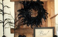 Halloween Mantel Decorating Ideas for Spooky Party : Halloween Mantel Decorating Ideas Black Feather Wreath On Wooden Planks Boo Writing In A Black Frame Three Small Black Skulls Two Black Branches On A Stand