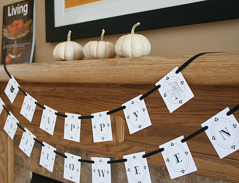 Halloween Mantel Decorating Ideas for Spooky Party: Halloween Mantel Decorating Ideas Happy Halloween Banner On A Fireplace Three White Pumpkins Living Magazine On A Wooden Fireplace