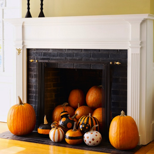Halloween Mantel Decorating Ideas for Spooky Party: Halloween White Mantel Decorating Ideas Large And Small Pumpkin Painted Pumpkin Inside The Fireplace Twin Black Candle Stands