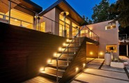 Luxury Modern House In Small Town For Family Gathering : Hidden Lamps Wooden Stairs Wooden Floor Yellow Lighting